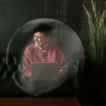 woman wfh on laptop in bubble